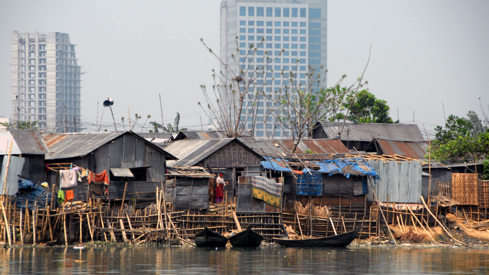 high-rise buildings and informal settlements in Dhaka